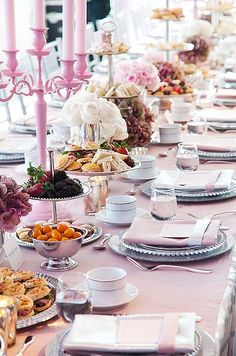 Afternoon tea doesn't have to be stuffy. Take a cue from the Mad Hatter and use tiers of finger sandwiches and sweets as edible centerpieces. The pink candle holder is gorgeous! Pink Wedding Receptions, Wedding Reception Table Decorations, Wedding Ideas, Wedding Table, Wedding Details, Diy Wedding, Dream Wedding, Wedding Inspiration, Afternoon Tea Wedding