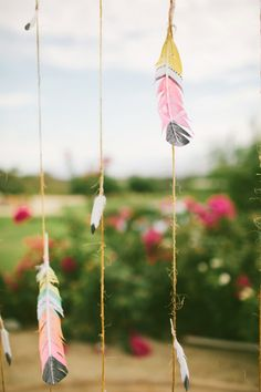 Painted feather Southwest-inspired ceremony backdrop.