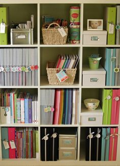 IKEA Expedit to organize scrapbook supplies...I also liked the ribbon wrapped around the spine of the scrapbooks to mark them with what they are!