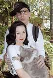 it's Marilyn Manson petting a koala bear with Dita Von Teese. this is the best thing ever! c: