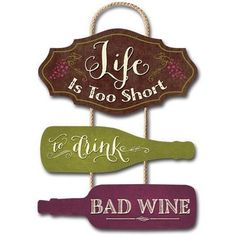 """This colorful trio plaque brings humor to the life of wine lovers with the message """"Life Is Too Short To Drink Bad Wine"""". Vintage rustic style lettering, grape vine designs and wine bottles on a rope hanger make a special addition to your home.   Proudly made in the USA, this trio plaque sign measures approximately 12"""" w x 18"""" h x .25"""" d."""