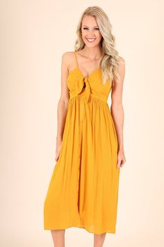 $36 Mustard midi sundress has ribbed back and self tie for adjustable fitting in bust. Dress also has adjustable straps for lengthening. Comfortable fit for any outting.