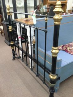 $299 - This antique bed is cast iron with brass. It is a full size headboard footboard and original iron rails. The bed measures 54 inches across and 78 inches long. The headboard stands approximately 60 inches tall.  The bed is on vintage heavy wheels. It can be seen in booth D 13 at Main Street Antique Mall 7260 East Main St ( E of Power Rd ) Mesa 85207  480 9241122open 7 days 10 till 530 Cash or charge 30 day layaway also available