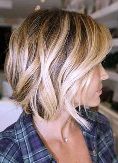 Messy Curl Bob - Women who love their long, curly hair but feel like they can no longer pull it off will fall in love with this boho-chic style including soft waves and side-swept bangs. Length just below the chin draws the eye in to just the right focus near the cheekbones.