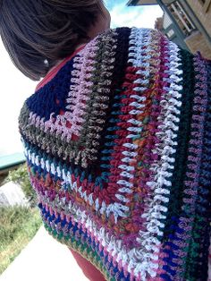 It's Just A Triangle, free pattern by Sharon Maher.   Stitches are made in the space between stitches; good for Homespun or other boucle yarn.  #crochet #shawl #wrap