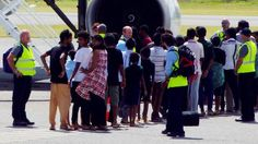 A group of asylum seekers get on board an airplane at Cocos Island on Sunday, July 27, en route to Curtin detention centre in Western Australia. http://www.smh.com.au/federal-politics/political-news/false-imprisonment-claims-heard-in-high-court-over-157-tamils-held-on-boat-for-a-month-20140728-3cpr3.html