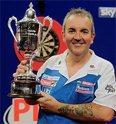 Phil 'The Power' Taylor. Born 13 Aug 1960 in Burslem, Stoke-on-Trent. Is an English professional darts player.