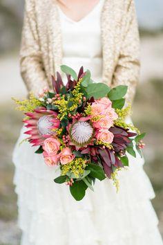 Giant Protea + Rose Bouquet, love the bold colors and variety of unique flowers Bouquet De Protea, Protea Wedding, Floral Wedding, Rustic Wedding, Peacock Wedding, Chic Wedding, Spring Wedding, Bridal Bouquets, Simple Weddings