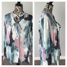 Mossimo Watercolor Beautiful Tunic Top Mossimo Watercolor Beautiful Tunic Top. Very nice quality and in perfect condition. Size XL would fit a Large as well. Would look cute worn as an oversized tunic with skinny jeans. See pictures for details. Please feel free to ask questions :)! Thank you for looking at looking at my listing.  * I offer bundle deals* 10% off 2 items, 20% off 3 items & 30% off 4 items or more :)!  Sorry no trades at this time. Xhilaration Tops Blouses