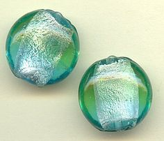 33041  Mint and Aqua Foil Puff Coins, 6  The colors of summer can be found within these luminous lampwork puff coins.  These mint and aqua beads are enhanced by a thin layer of silver foil on the interior for added dimension.  Combine the blue and green shades with silver accents for a lovely pair of beach-y earrings.