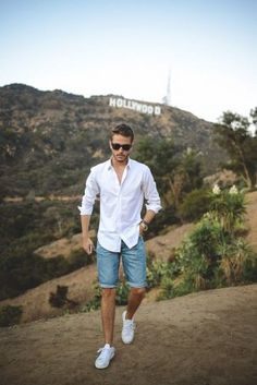 Shorts blue shirt and white shoes