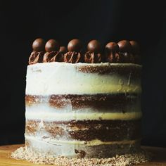 This semi-naked, malted chocolate layer cake is a chocoholics dream.