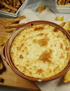 Hot Onion Souffle Dip (3 (8 oz.) packages cream cheese  2 c. shredded Parmesan cheese  1 c. mayonnaise  2 1/2 c. finely chopped onion)