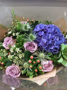 Hydrangea, Memory lane roses, Silver thistle and Hypericum made by Alice