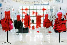 Shades of red and beautiful roses in the Summer collection of Comme des Garçons.