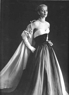 Evening gown and stole by Pierre Balmain, French, 1959. Photo by Willy Maywald.