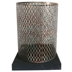 A&B Home Hurricane. The A&B Home Wood and Metal Hurricane Candle Holder - Black/Silver is a unique way to add candle power to your dinners and parties. A colorful pillar candle can mix or match your decor with bright accents.