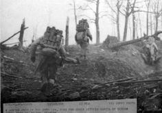 A mortar crew of the 20th Division runs for cover between bursts of German shell fire in Julich, Germany. 23 February 1945.