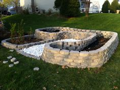 raised vegetable garden beds - I love this stone one!