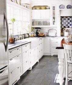 Slate floor tile. Like the medium grey with darker grout.