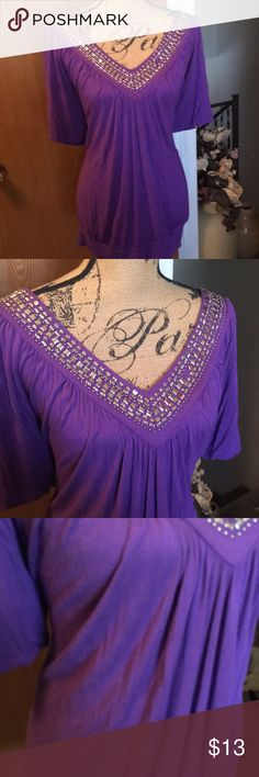 Torrid 1 Beautiful top . Stretchy with thicker material . Older style torrid . Pic of beadwork shows where one fell off . torrid Tops