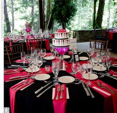 Round reception tables were topped with black tablecloths and two crisscrossed bright pink table runners. The table cakes sat in the middle in lieu of traditional floral centerpieces.I like the fusia pink against the black very romantic and sexy Black Wedding Themes, Pink Wedding Theme, Black Wedding Dresses, Wedding Black, Wedding Flowers, Wedding Table Centerpieces, Reception Decorations, Floral Centerpieces, Wedding Tables