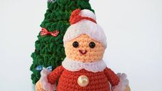 Christmas Toy Set - Christmas tree and Crocheted Mrs. Santa Claus  This set of toys will decorate your house for Christmas.   Crocheted Mrs. Santa Claus and the Christmas tree are very cute and pleasant. This Christmas set will be an excellent gift to a friend or child.   Height of the Christmas tree 23 cm (9.06)  The width at the bottom is 11 cm. (4.33)    Height crocheted Mrs. Santa Claus 12 cm ( 4.72 )  Down the diameter of the toy 5.5 cm ( 1.97 )    Stuffing material: Holofiber…