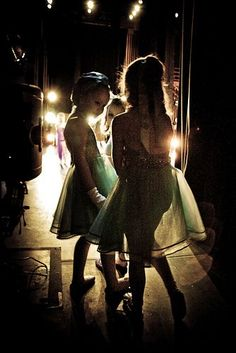 Little ballerinas wait in the wings backstage for their entrance