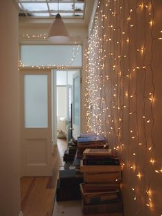 string lights. @Katie Nashland this is what I was thinking for the walls...so simple and elegant. you can hang toile over it as well....so pretty!