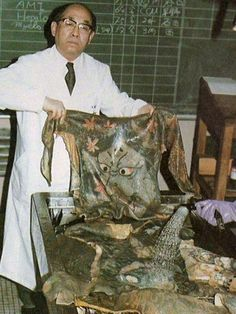 Dr. Katsunari Fukushi with a wet specimen from the preserved Japanese skin tattoo collection started by his father, Dr Masaichi Fukushi. Medical Pathology Museum of Tokyo University. 1983.