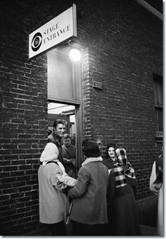Elvis chats with some very cold well wishers who came to greet him during near freezing weather the day he appeared for the first time on the Tommy and Jimmy Dorsey variety show, 'Stage Show', produced by Jackie Gleason. (CBS Studio 50, New York City, March 17, 1956).