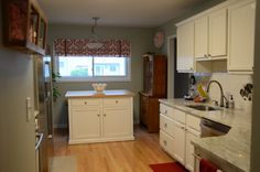 budget remodel; love the white cabinet and granite counter top