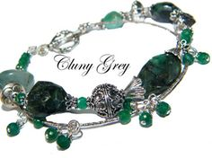 emeralds and sterling silver make up this emerald bracelet   http://www.clunygreyjewelry.com/emerald-bracelets.html