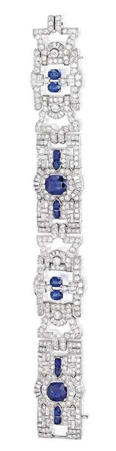 PLATINUM, SAPPHIRE AND DIAMOND BRACELET.  The articulated strap of openwork design, set with two cushion-cut sapphires weighing approximately 3.50 and 3.25 carats, accented by bullet-shaped, cushion and French-cut sapphires, further set with numerous baguette, old European and single-cut diamonds weighing approximately 13.00 carats, length 7¼; circa 1930.
