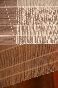 Thick and thin warp with pickup only between the middle thick warp threads.   Great effect!