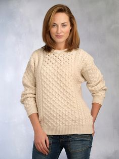 Made from 100% Soft Merino Wool this traditional Irish crew neck Aran sweater is one of our Special Offers.It follows all the traditional Aran stitching patterns that have been passed down from through generations. In olden days Aran patterns told stories of families and life in Ireland. Along the centre panel of the body the honeycomb Aran stitch flows, signifying the hard working bee or the hard work of a fisherman. Suitable for both men and women.