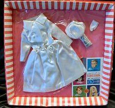 Vintage Barbie White Magic #1607 (1964) White Satin Coat White Satin Pillbox Hat Silver Dimple Purse Short White Gloves The white satin coat and hat were also part of the Satin Mix & Match Group Fashion Pak Group(1963) .
