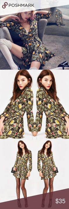 URBAN OUTFITTERS FLORAL ECOTE RUBY WRAP MINI DRESS Worn once. Great condition. Beautiful wrap dress with long sleeves and floral print. Size XS Urban Outfitters Dresses Mini
