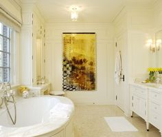 The art adds the color in this creamy bathroom...I love it!