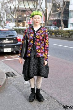 Shiho's look include a floral top by the legendary Japanese label Comme Des Garcons with a crinkled Comme Des Garcons skirt, fishnets, and Tokyo Bopper platforms. Shiho's milk crown design tote bag is also by the Harajuku brand Tokyo Bopper.