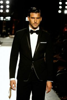The black suit with a bow tie..Classic men's style.