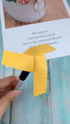 Simple foldable spinner or whirligig from strips of paper