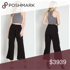 Black Pinstripe Tie Waist Pants Workday chic! These black pinstripe pants have on trend wide legs and a tie waist. Pair them with a lightweight sweater and you are ready for the day. The pants are lined and made of 70% cotton/ 30% polyester. The NEW Boutique Pants Wide Leg