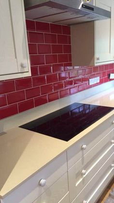 Gloss finished red metro tiled kitchen splash back. Gloss finished red metro tiled kitchen splash back. Metro Tiles Kitchen, Kitchen Splashback Tiles, Kitchen Mosaic, Black Backsplash, Subway Tile Kitchen, Glass Kitchen, Kitchen Cabinets, Kitchen Backsplash Inspiration, Backsplash Ideas