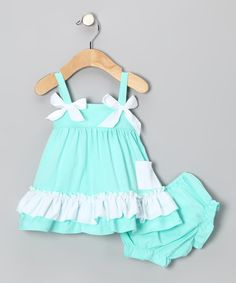 The ruffle trim and perky bows make this top perfect for a maven in the making! Little ones will appreciate the relaxed fit and comfy cotton feel, while the diaper cover delicately masks a derriere with ruffles and matching colors.Includes top and diaper cover97% cotton / 3% spandexMachine wash; tumble dry