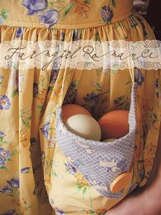 <3 eggs in the pocket of a yellow apron