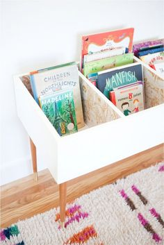 Here's a DIY book bin that brings books down to the kids' level. Check it out on This Little Street.