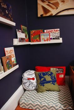 How dramatic is navy against white? Plus, the red accents & chevron pillow pattern pop against navy blue in this cozy reading corner.  Using color effectively can enhance any kids' space. The right placement of light or dark colors creates the drama kids love in a room they call their own.
