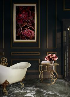Design Inspiration - Koket furniture and designs  Marble floors and midcentury side tables combined with this divine bathtub - to die for.