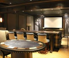 This multi-purpose rec room by Harmony Interiors is a bar, game room and home theater in one.